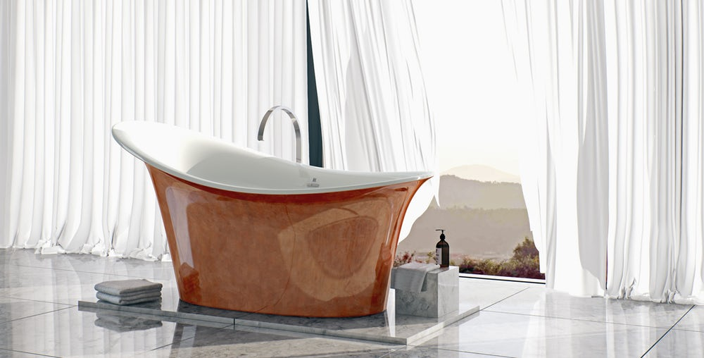 Copper red Fontana freestanding bath on a grey tiled floor next to an open window with white curtains flowing in the background