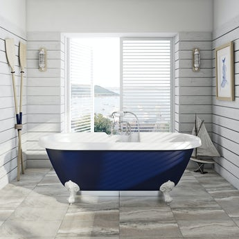 Navy blue coloured bath with tap and waste