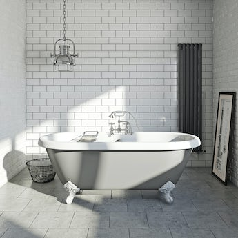 dove grey coloured bath with tap and waste